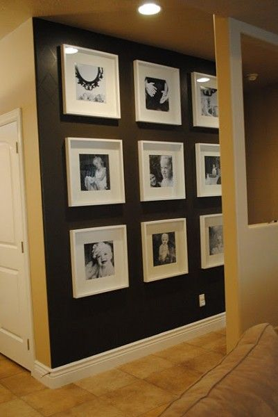 I really like this photo gallery with the wall painted black.  I don't usually like black walls, but for one well-lighted wall with black and white photos, it looks fabulous!