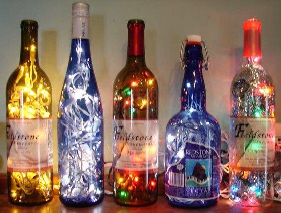 Glass bottle lights - use up those old tiny Christmas tree bulbs! http://www.the-pregnancy.net/diy-bottled-christmas-lights.html