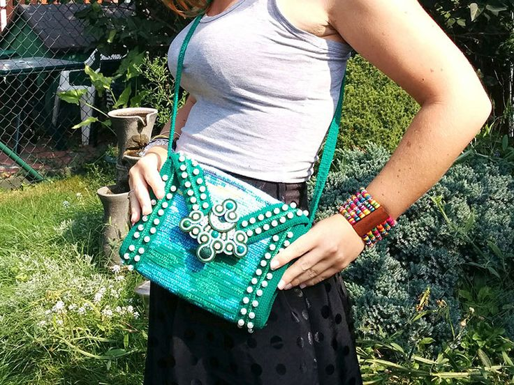 This small handbag was made mainly in crochet technique (tapestry crochet and sequins embroidery). The flap is decorated with a soutache element. Interior: dark jeans, with two pockets (for smartphone, pen, cards and such...). The strap length: 98cm (38,5 inch). Dimensions of the bag: 21cm x 17cm x 5cm (8,2 inch x 6,7 inch x 2 inch). Purpose: best in tourist trips and holidays - it can hold a wallet, smartphone and few necessary trifles like notepad, pen, tickets.