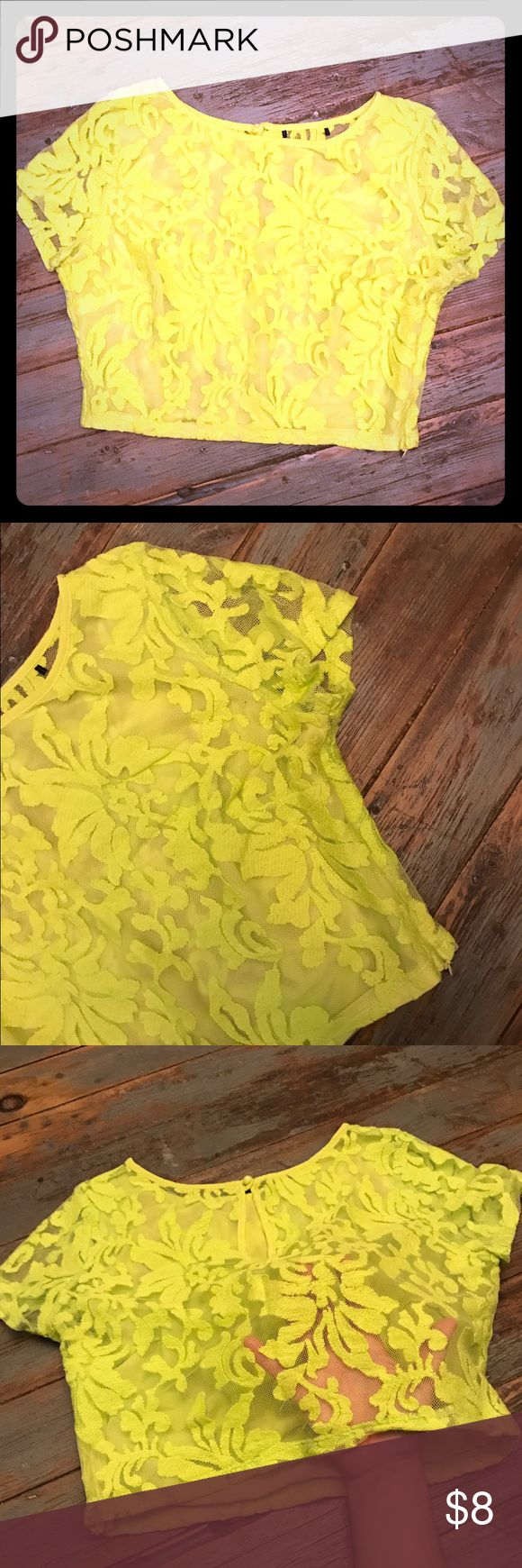 Neon Yellow Sheer Lace Crop Top Forever 21 Neon Yellow Lace Crop Top - Front Lined - Sleeves and back are sheer. High Neck - key hole with button detail - side zipper . Worn once! (Cut large black tag out of back because it looked terrible through the sheer back). Forever 21 Tops Crop Tops