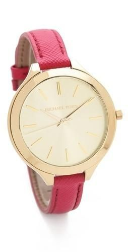 FREE SHIPPING at shopbop.com. A delicate leather band balances the oversized dial of this gold-tone watch. Adjustable length and buckle closure. Water resistant to 50 meters. 2-year... M