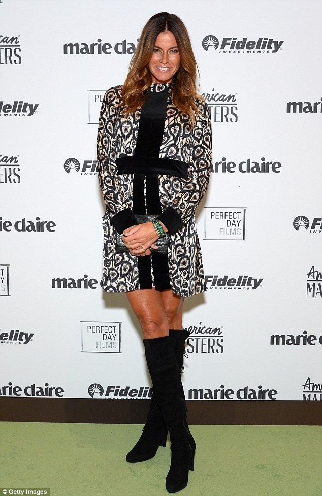 Kelly Bensimon steps out in knee-high boots and boldly patterned frock