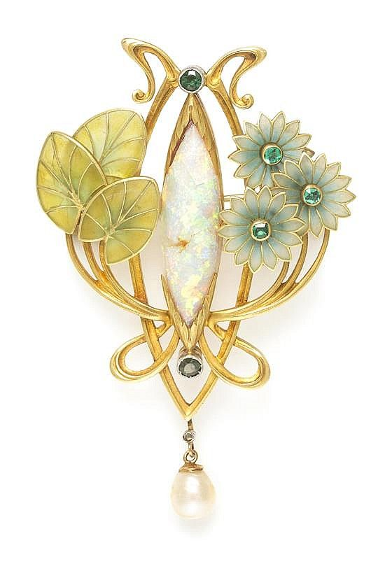 An Art Nouveau Platinum Topped Gold, Opal, Emerald, Pearl and Polychrome Plique-a-Jour Enamel Pendant/Brooch, open wirework gold setting containing a central navette shape cabochon cut opal accented at the terminals with two round mixed cut garnet and glass doublets, accented to the left with three yellowish green plique-a-jour enamel leaves and to the right with three green plique-a-jour enamel flowers centered around step cut emeralds, pendant suspends a rose cut diamond and baroque pearl.