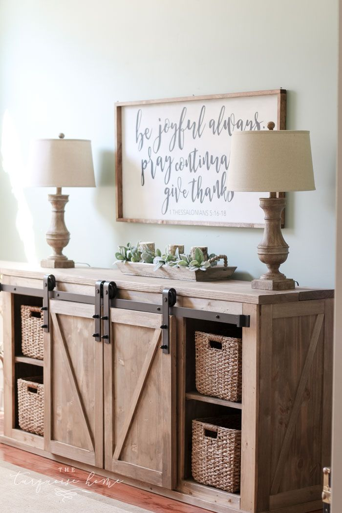This DIY Farmhouse Media Console Table is both beauty and beast. It is gorgeous with the rustic weathered wood and a beast of a storage unit with two sliding barn doors to cover the junk and four basket drawers to hold even more! And it's not hard to build at all.