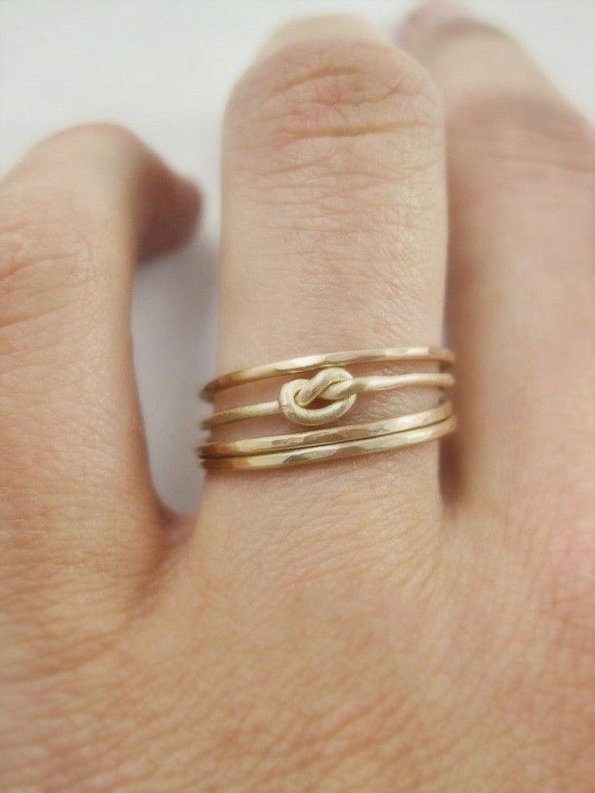 A little obsessed with this simple knot wedding ring. | See more simple #wedding rings here: http://www.mywedding.com/articles/simple-wedding-rings-youll-love/