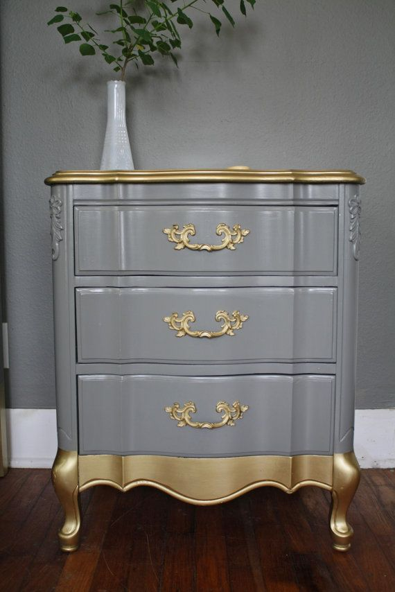 Giving an old chest of drawers the Hip Heritage look using stove pipe grey and old gold paints to great effect.