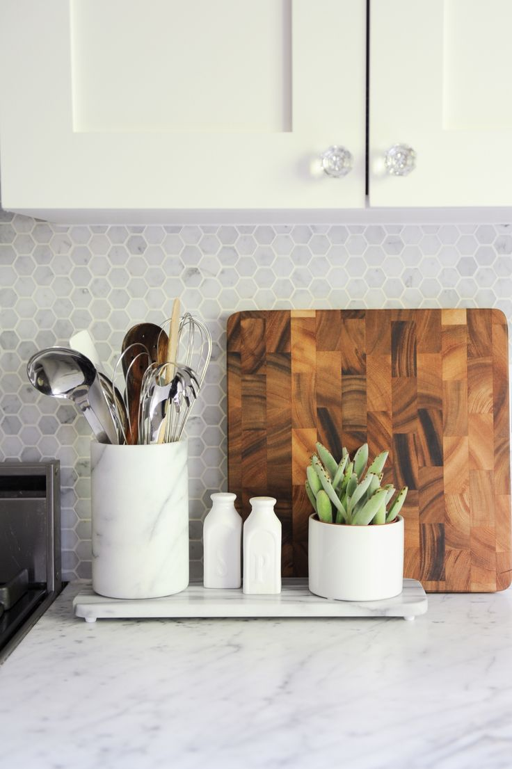 Kitchen accessories to keep in mind are cutting boards, small accent plants, Salt and pepper shakers, and Serve ware.