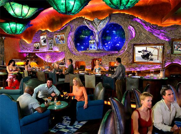 Check out this unique Las Vegas Bar & Restaurant! Mermaid Lounge gives you to a mythical and magical experience while enjoying specialty cocktails and menu items. The view is a spectacular 117,000-gallon saltwater aquarium with 4,000 fish and mermaids!
