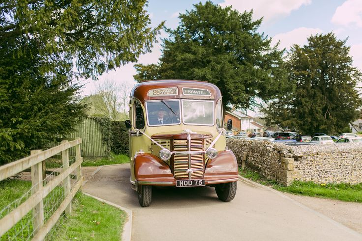 Old buses are brilliant ways of getting the entire bridal party to the church on time. Photo by Benjamin Stuart Photography #weddingphotography #weddingbus #bridesmaidride #englishwedding