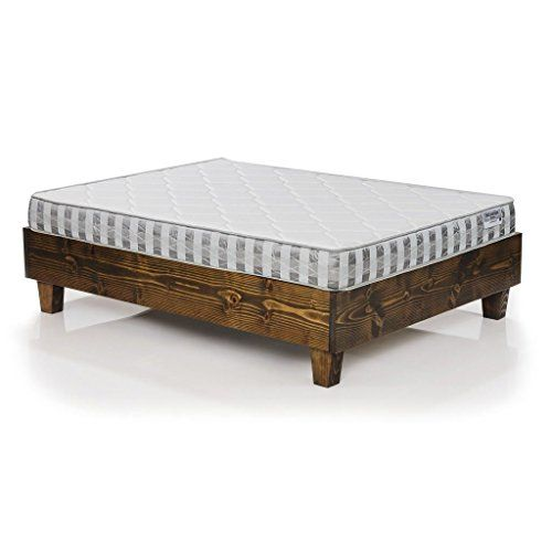 """Solid wood platform bed frame finished with our Jacobean wood stain. The footboard, headboard and side rails are all built with solid 1 1/2"""" x 10 3/4"""" Douglas Fir lumber to offer a beautiful splash of rustic flair. The chunky tapered legs add a bit of sleekness to an otherwise rustic profile."""
