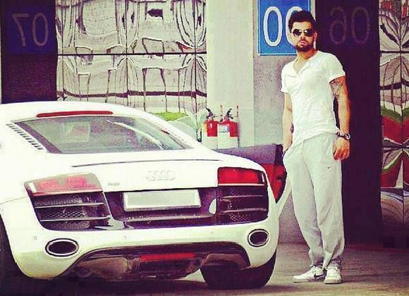 Indian Cricket Batsman Virat Kohli with His Audi R8.