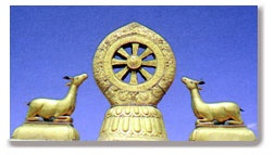 This is the Dharma wheel statue that is on top of a temple in Tibet.