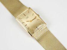 Klassische Uhr in 585 Gelbgold mit weich fliessendem Armband, Gewicht 49,7 Gramm