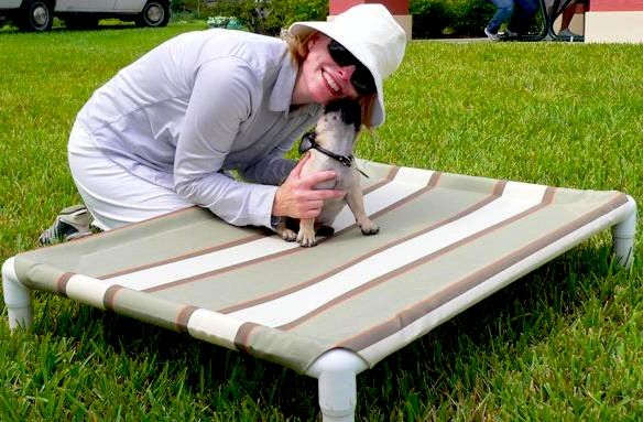 DIY elevated Kuranda style dog pet bed. I love the idea of creating slits down inner side of the pipe and using a thicker dowel to slip the fabric in- easier to take out and wash, more difficult for the   dog to chew