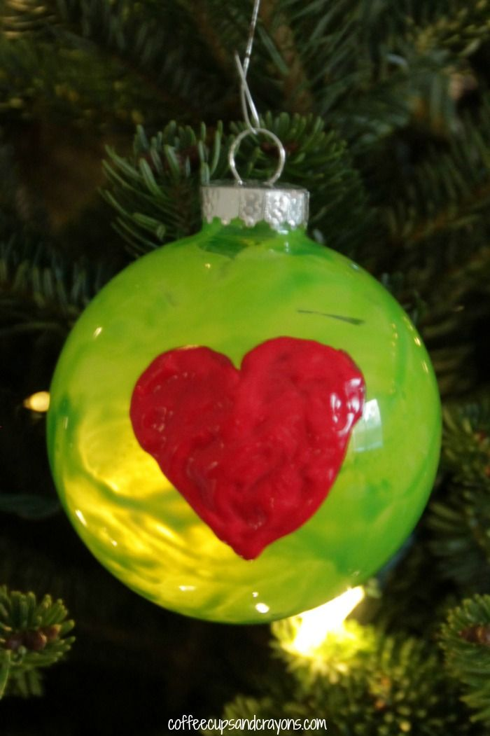 How the Grinch Stole Christmas by Dr. Seuss is one of our family's favorites so of course we had to make a Grinch Christmas ornament!