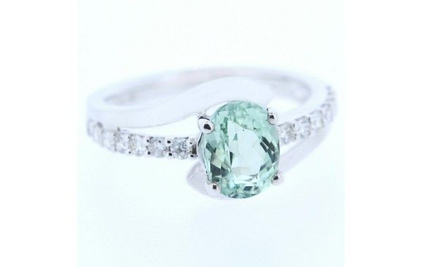 18ct white gold and diamond ring, featuring a light green tourmaline.
