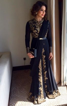 Bipasha Basu dons a sabyasachi half saree with full length blouse. Indian Bollywood fashion.