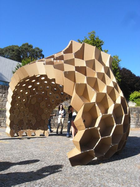 mathematical hexagon igloo sturcture made from cardboard. It looks pretty awesome and like a beehive.