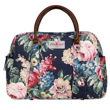 Our lovely Bloomsbury bowling bag is based on a classic vintage design and is roomy enough for all your daily essentials. It is finished in our durable matt oilcloth with leather handles and zip pulley, and has an internal zip pocket and two handy side pockets with popper fastenings.