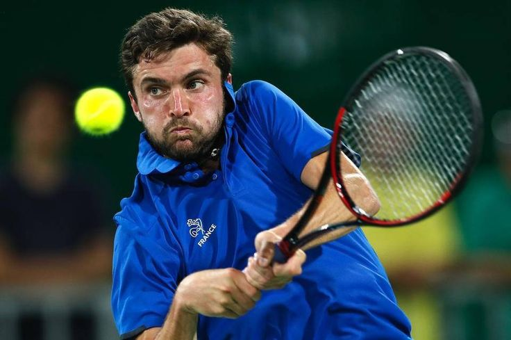 France's Gilles Simon returns a ball to Croatia's Borna Coric in the men's tennis competition at the 2016 Summer Olympics in Rio de Janeiro, Brazil,…