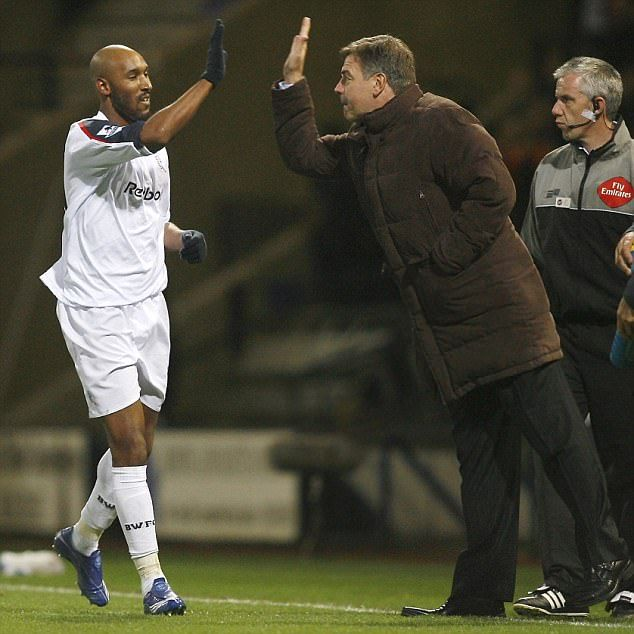 Nicolas Anelka dishes out a high five to Allardyce during a Bolton win over Arsenal
