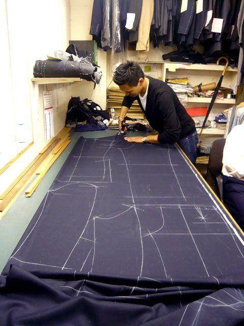 Koichi cuts his coat at Richard James, Savile Row