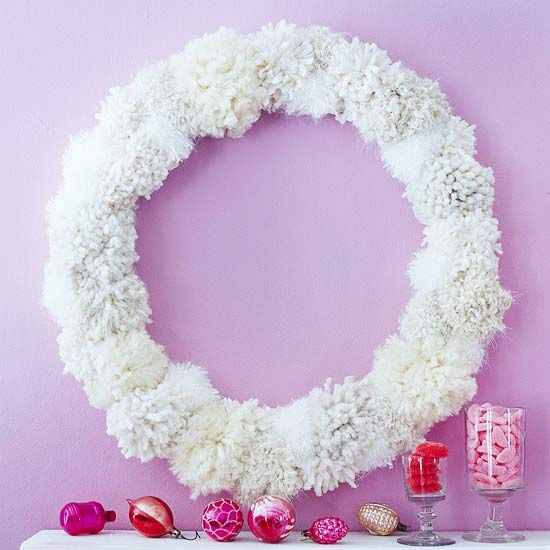 Frosty Fuzz Wreath  Using a variety of yarns, make pom-poms of different sizes to cover an 18-inch wooden wreath form. You can buy pom-pom-making kits at crafts stores. Adhere the pom-poms using hot glue.