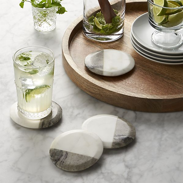 Marble remnantsused to create our 2-tone marble boards are crafted into these sleek, contemporary coasters with protective foam feet. Stain-resistant marble coasters will display unique combinations of natural color, texture and veining.
