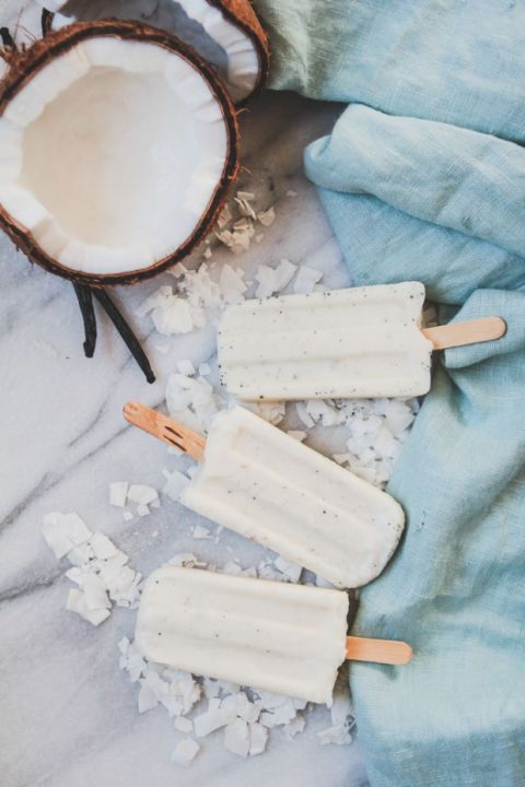 COCONUT CREAM POPSICLES WITH VANILLA BEAN AND MALIBU RUM Boozy popsicle cocktails made with alcohol Take yourself on a mini vacation with these tropical popsicles. All that's missing is the tiny umbrella! Get the recipe at The Modern Proper.