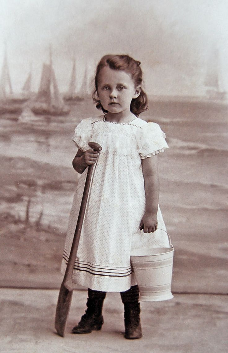 +~+~ Antique Photograph ~+~+  Girl with a sea side backdrop.