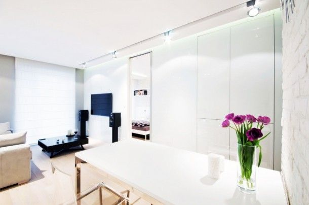 Apartment - Unique Open Floor Dining And Living Room Design At White Water Apartment With Glass Flower Vase On White Table: Stylish and Uniq...