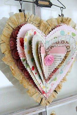 diy layered hearts. looks like the last layer is from a sewing pattern... love it. tutorial.