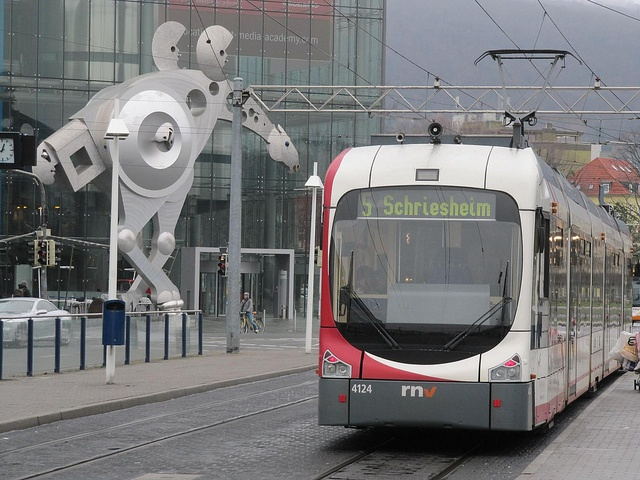 Heidelberg tram and sculpture 2313 by TheophileEscargot, via Flickr