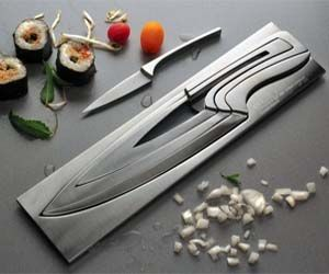 Modern Knives SetCombine form and function with this innovative and modern stainless steel knives set. This cleverly designed set of knives looks like a solid piece of steel initially, but in fact each one of the four included knives can be pulled off from the block.