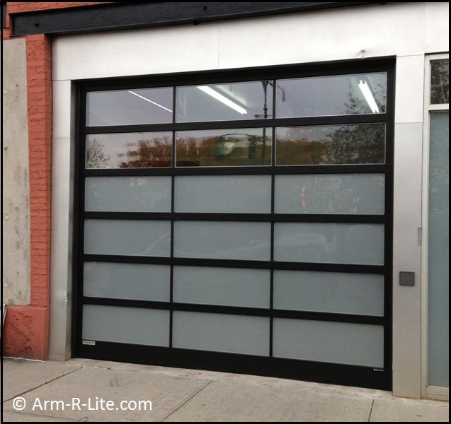Designer glass garage door by Arm R Lite with frosted and clear glazed sections. 1000  images about Museum and Gallery Glass Garage Doors on