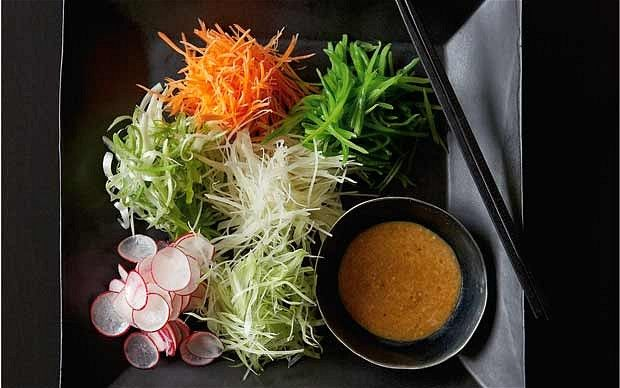 Japanese salad  For the salad  2 spring onions  6-7 radishes  1 carrot  1 small potato  1 stick celery  75g (2¾oz) mangetout    For the dressing  3 tbsp sesame seeds, toasted and ground  2 tbsp soy sauce  2 tbsp rice vinegar  1 tbsp olive oil  black pepper