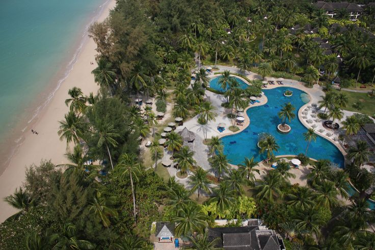 Above one of the 5 swimming pools at Pullman Khao Lak Katiliya Resort and Villas. Paradise on your door step... www.pullmankhaolak.com