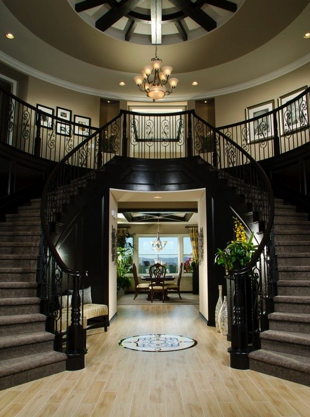 Double Staircases And A View To The Dining Make A Dramatic