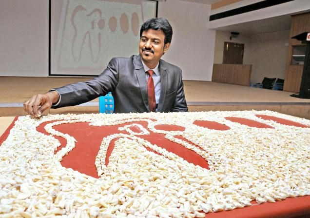 """Madurai Dentist gets in Limca Record for collecting 10,000 non carious teeth Dr Jibreel Oysul, chief of dental surgery unit in Meenakshi Mission Hospital and Research Centre here, has entered Limca Book of Records 2016 for the """"most extraction and the largest collection of non-carious human teeth. Speaking to media persons on Thursday, Dr. Oysul said that he had extracted, processed and collected 10,000 teeth since January 2011.."""