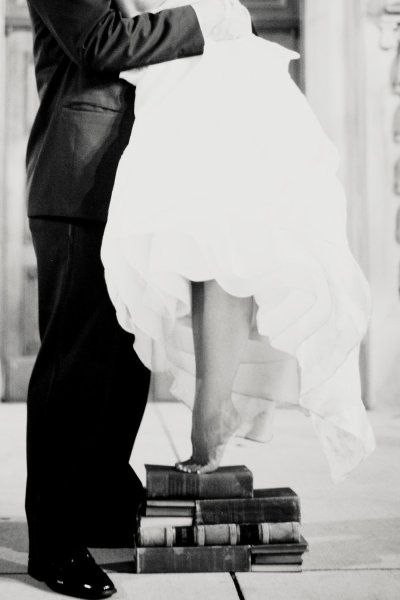 Bride on Tip-Toes AND a Stack of Books.  Love, mainly because that kind of height is a requirement. :)
