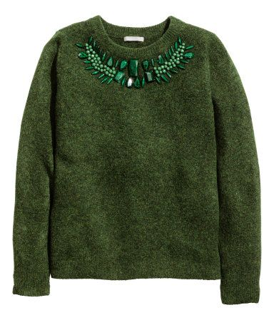 Dark green knit sweater with wool content and a napped finish. Faceted plastic bead decorations at front. | Warm in H&M