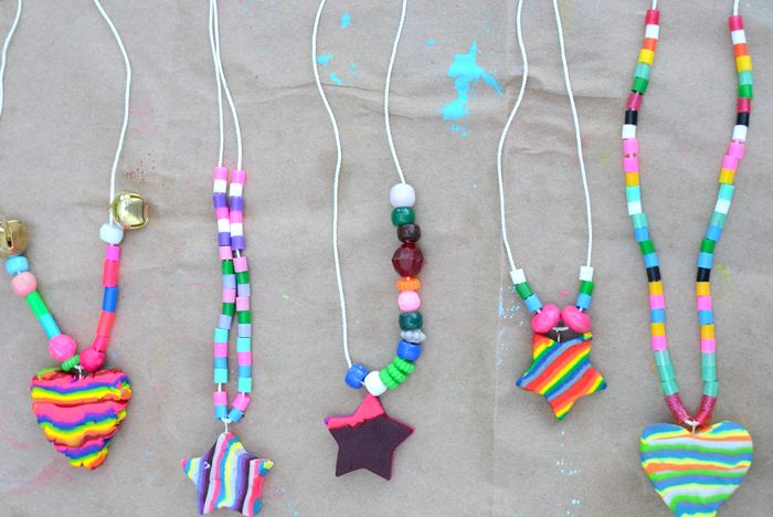 Kid made rainbow necklaces, any color or pattern they choose. Use cookie cutters and beads to make them unique