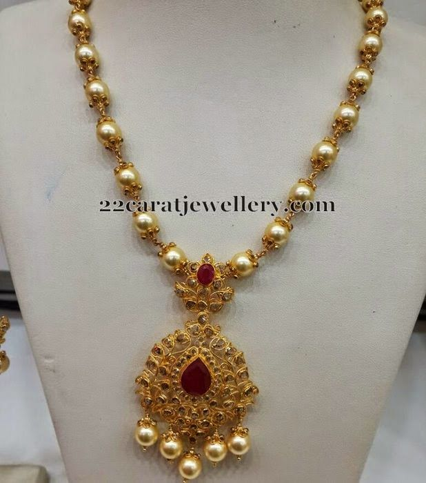 22 carat gold metal intricate south sea pearls long chain with two step uncut diamond pendant. Studded with flat diamonds, pink rubies ac...