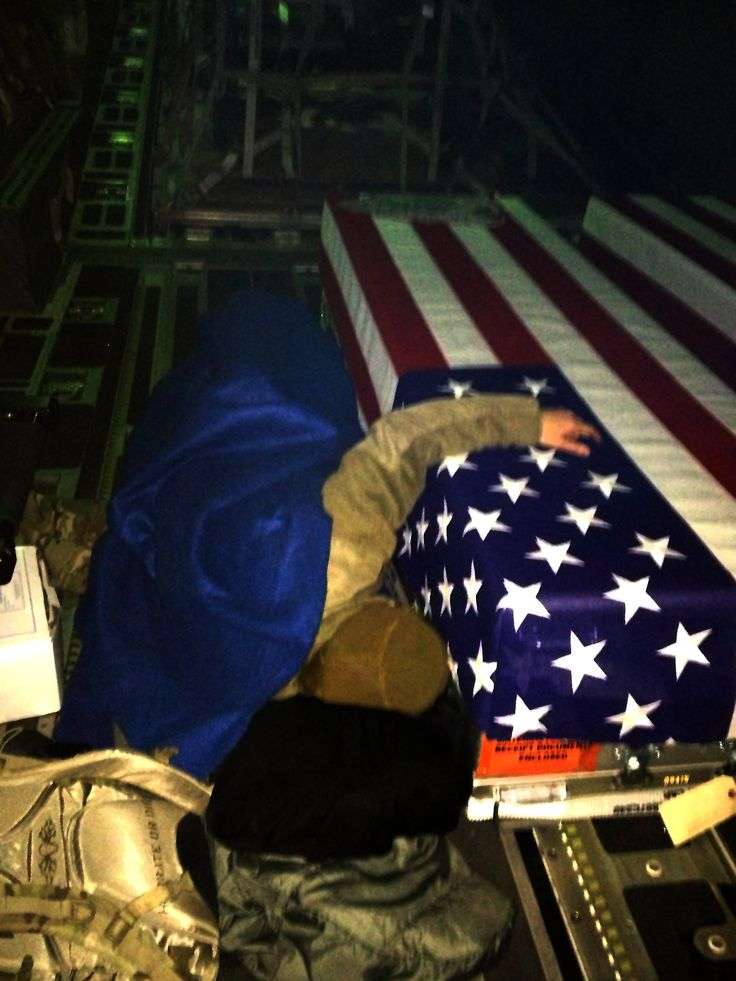 Capt. Dana Lyon's lies next to her husband's, Capt. David Lyon) coffin during transport back to the states from Afghanistan. The Air Force named the service's newest pre-positioning vessel after Capt. David Lyon, who died Dec. 27, 2013, in Kabul, Afghanistan, when a vehicle-born improvised explosive device was detonated near his convoy. (Courtesy photo)