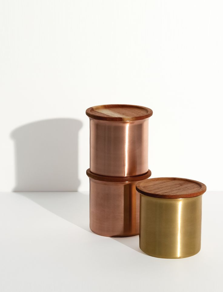 Stackable storage containers made from spun brass or copper, with lids in ayurvedic Neem wood. Neem wood is used across India for its antibacterial properties.