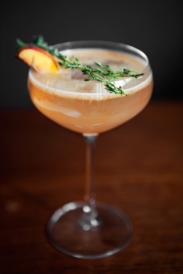 Nectarine Thyme Gin Cocktail-yum!   Nectarine Infused Gin  4 cl (1.5 ounces) Gin  4 cl Thyme syrup (recipe below) 4 cl Lime 1/2 Nectarine Fresh Thyme Ice Cubes Splash of Champagne or Sparkling water  Thyme Syrup recipe (you can keep it in the fridge for 2 weeks)  5 dl (2 cups) sugar 5 dl (2 cups) water 3-4 handfulls fresh thyme
