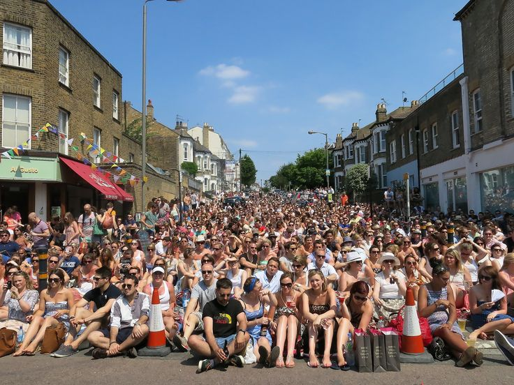 Beautiful shot of the crowd watching the Wimbledon Men's Final at the Northcote Road Summer Fete, Battersea.