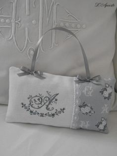 Pad with monogram embroidered cross stitch and lace. Shabby