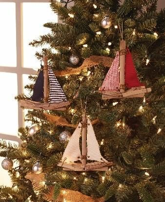 DRIFTWOOD SAILBOAT ORNAMENTS. Rustic driftwood and twill ornaments feature red, blue, or natural color lashed and grommetted sails!