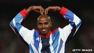Gold medallist in the men's 5,000m Mo Farah of Great Britain celebrates on the podium (11 August)